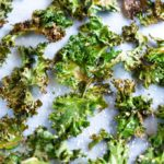 baked kale chips close up on sheet tray