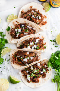 Slow Cooker Pork Carnitas Tacos with cilantro and limes