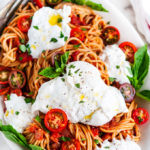 Tomato Basil Spaghetti with Burrata on a Serving Platter with Fork