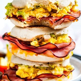 Make Ahead Freezer Breakfast Sandwiches stack with eggs, ham, and avocado