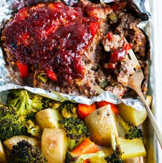 Sheet Pan Meat Loaf and Veggies close up with gold fork