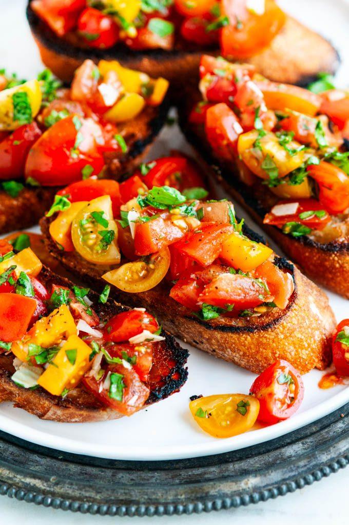 Tomato Basil Bruschetta close up on a white plate
