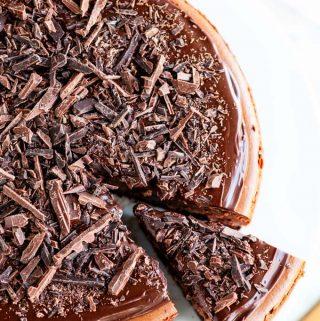 Triple Chocolate Cheesecake slice with chocolate ganache and chocolate shavings