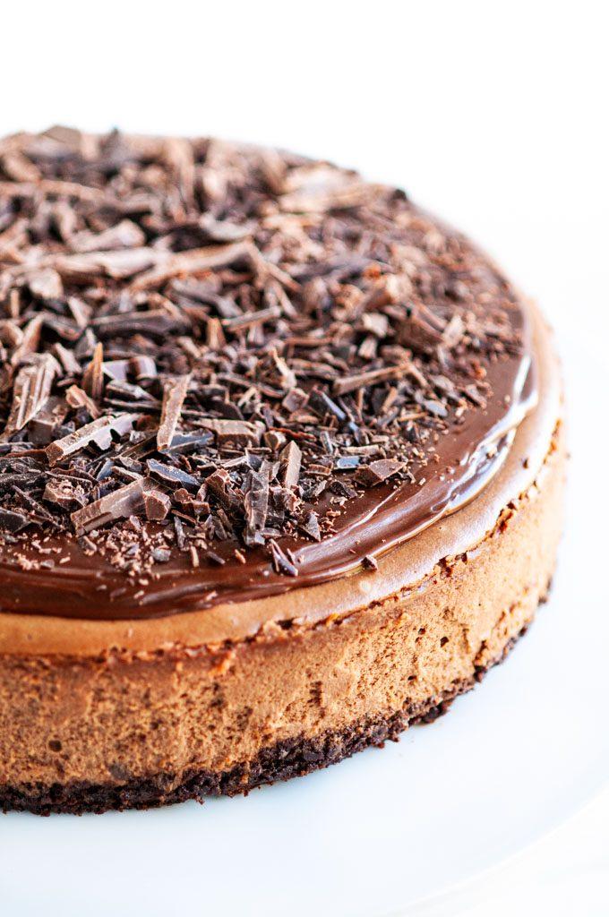 Triple Chocolate Cheesecake with chocolate ganache and chocolate shavings close up