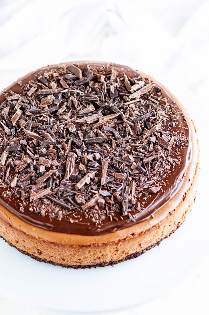 Triple Chocolate Cheesecake with chocolate ganache and chocolate shavings