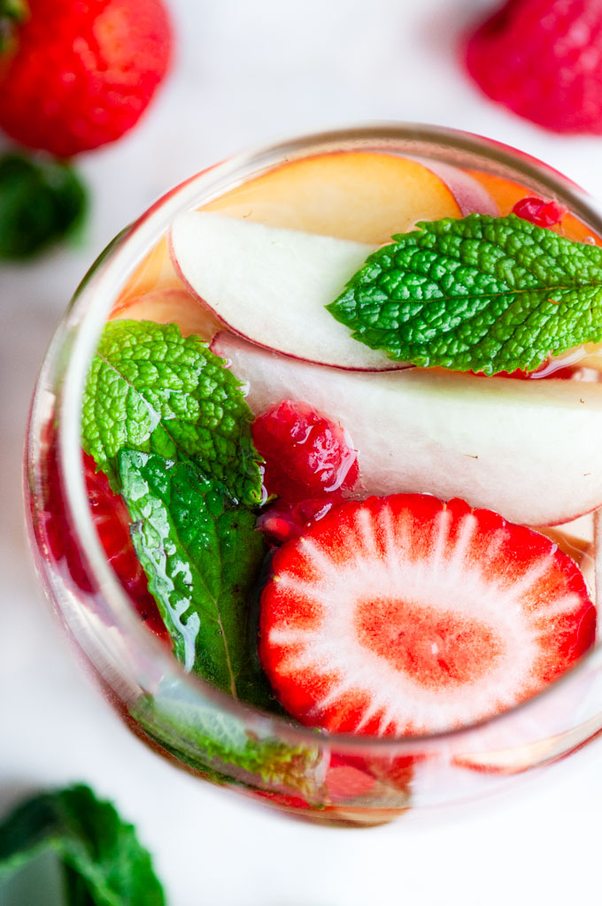 Peach Strawberry White Wine Sangria in wine glass with fruit