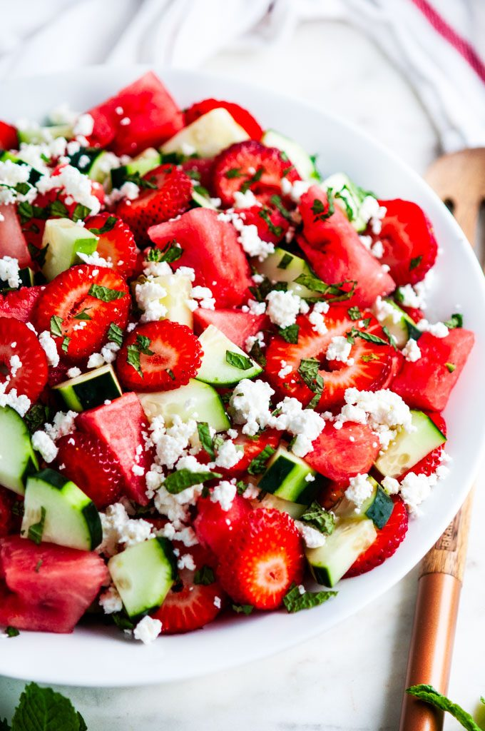 Watermelon Strawberry Cucumber Salad with wooden serving spoon