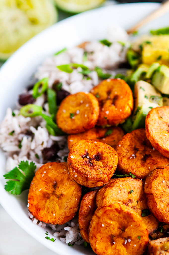Cuban Chicken Bowls with Fried Plantains with gold fork
