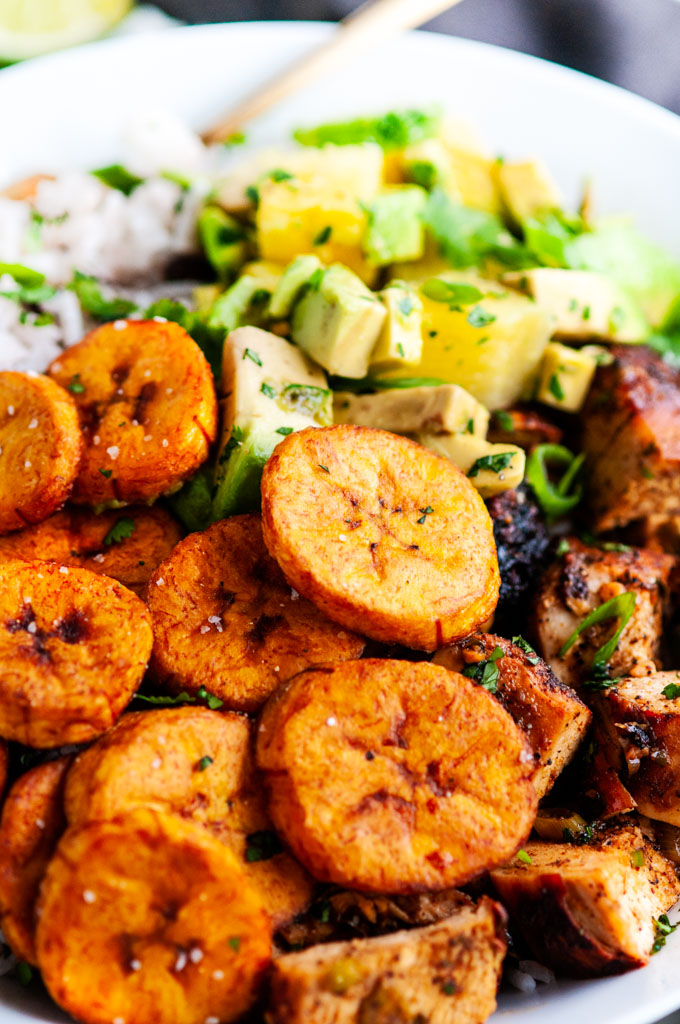 Cuban Chicken Bowls with Fried Plantains with gold fork and gray towel close up