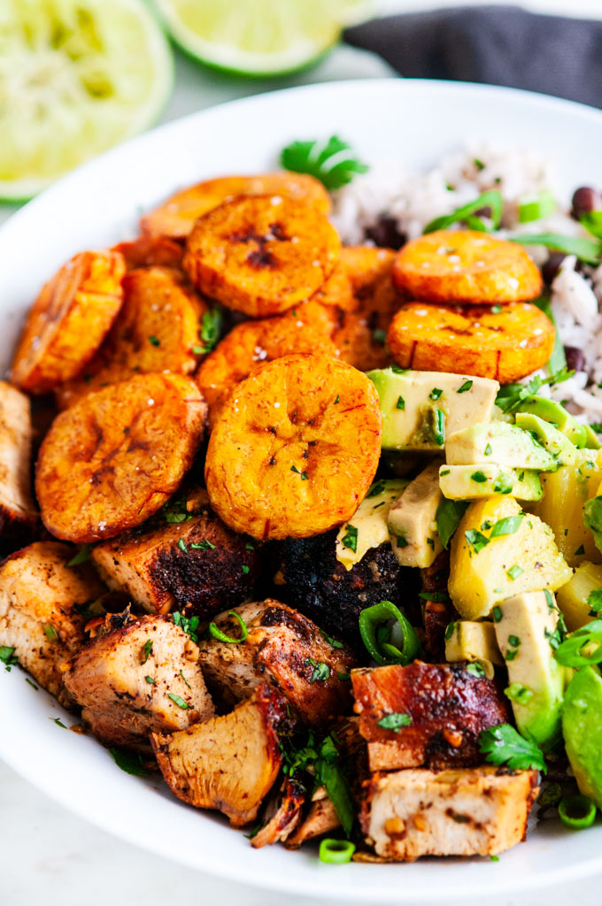 Cuban Chicken Bowls with Fried Plantains with gold fork and gray towel