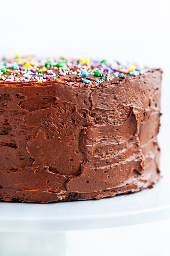 Devil's Food Cake with Chocolate Buttercream Frosting close up with sprinkles