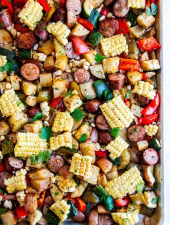 Sheet Pan Sausage and Veggies on baking pan white background