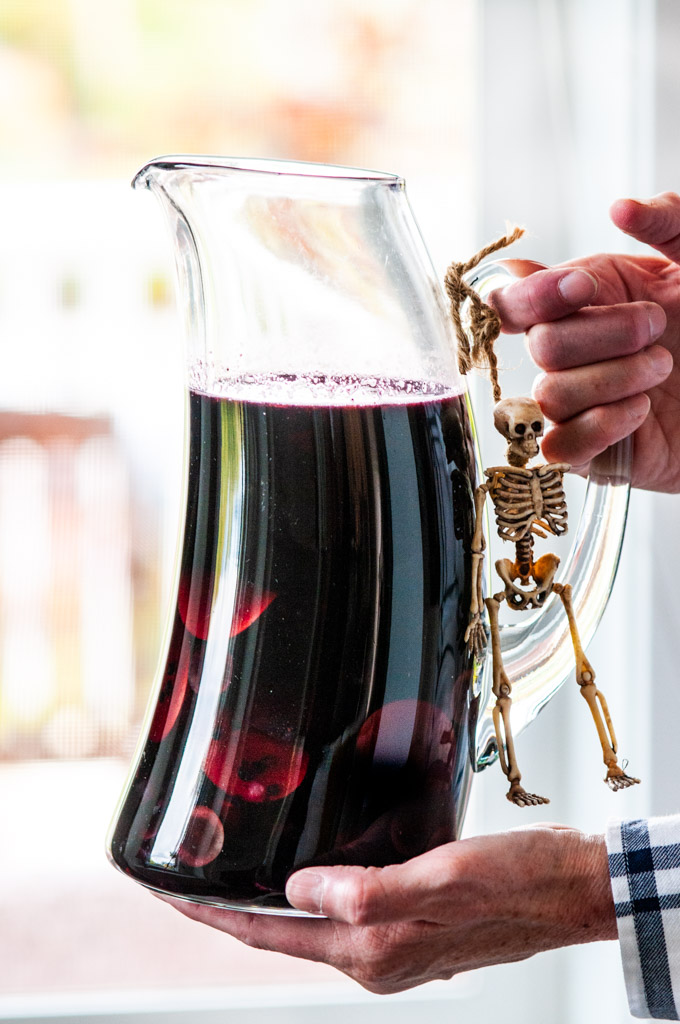 Halloween Witches Brew Black Sangria pitcher with skeleton toy