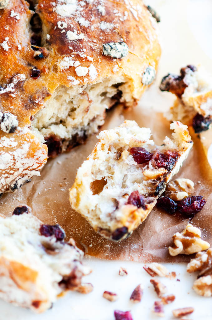 No Knead Cranberry Nut Bread baked slice and torn pieces with parchment paper