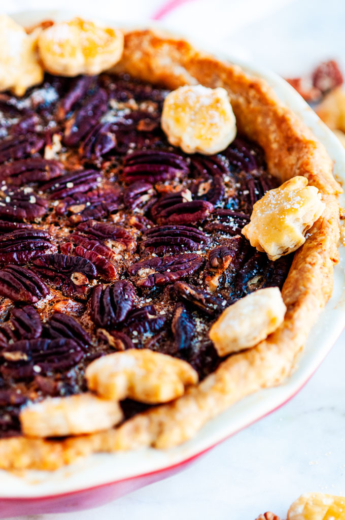 Deep dish bourbon pecan pie on marble with white towel