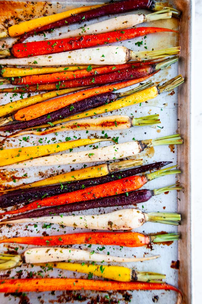 Honey garlic roasted carrots on gray baking sheet