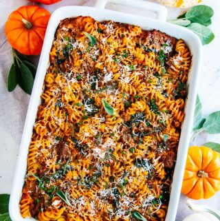 Pumpkin Sausage Spinach Pasta Bake in white pan