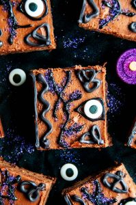 Winifred's Spell Book Hocus Pocus Brownies on black fabric with glittery candles