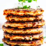 Cheesy Garlic Leftover Mashed Potato Pancakes stack with sour cream stack center side view