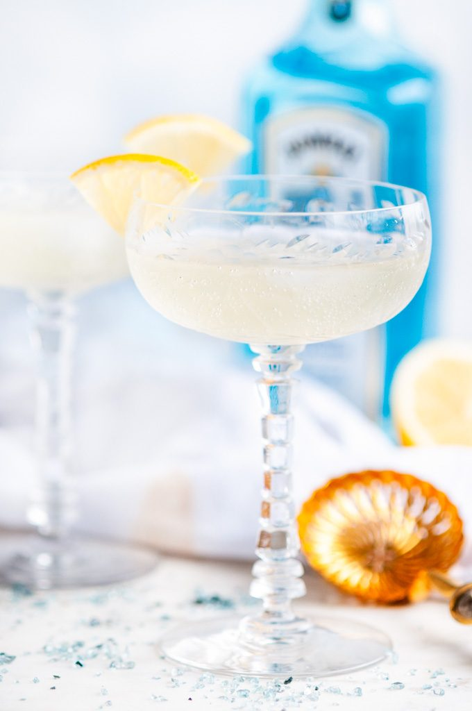 French 75 Cocktail with gold strainer and bombay sapphire gin