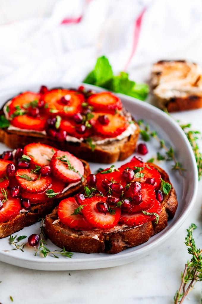 Strawberry Mascarpone Cinnamon Raisin Breakfast Toast on white plate with mint