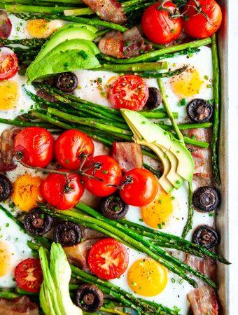 Sheet pan breakfast bake with tomatoes, eggs, asparagus, mushrooms, bacon and avocado