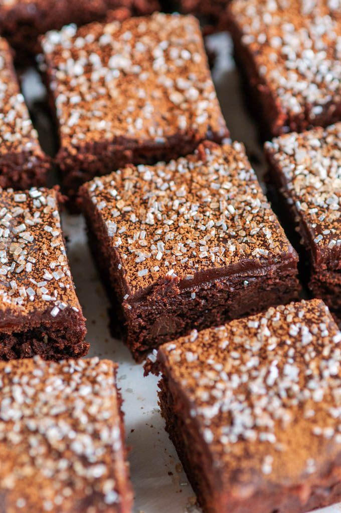 Baileys Irish Cream Brownies with Chocolate Ganache topped with cocoa powder and silver sprinkles