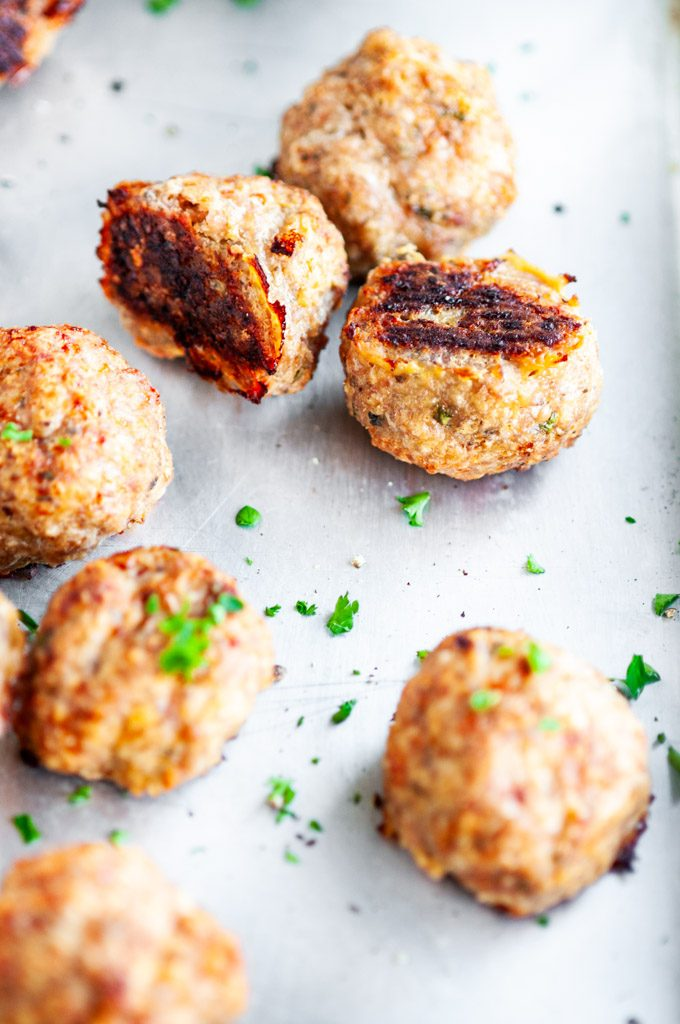 Baked Turkey Meatballs on sheet pan with parchment paper