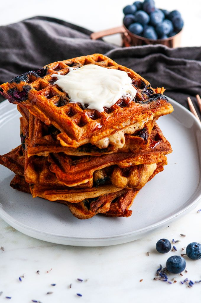 London Fog Blueberry Waffles with copper silverware and gray tea towel