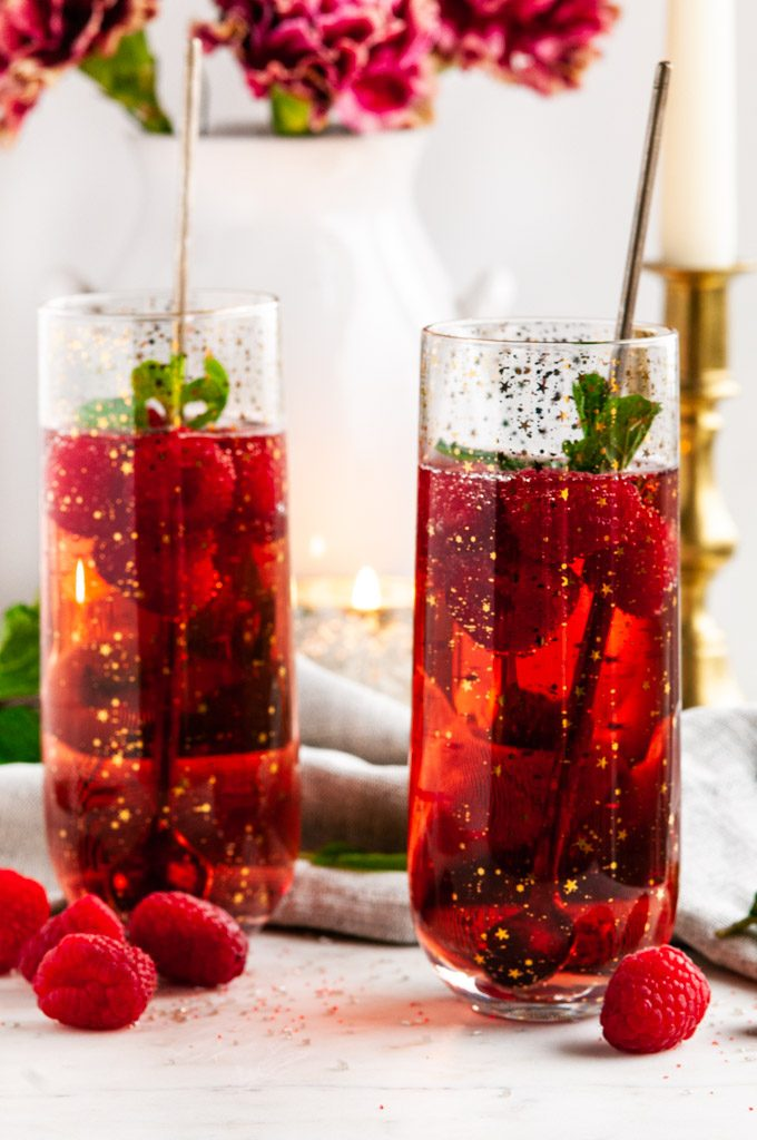 Raspberry Rosé Gin Fizz Cocktail with mint and gold spoons