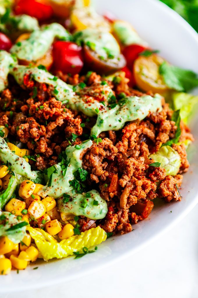 Turkey Taco Salad with Cilantro Avocado Dressing in a white bowl