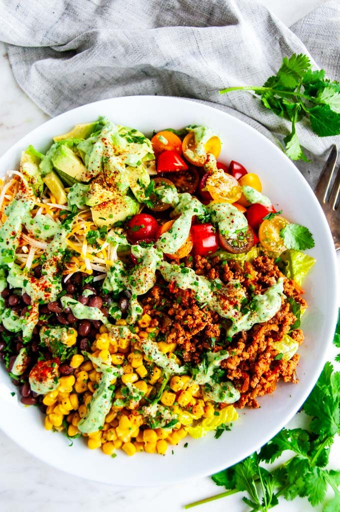 Turkey Taco Salad with Cilantro Avocado Dressing in a white bowl with antique silver fork
