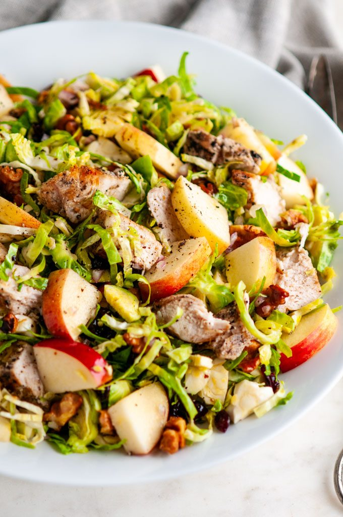Chicken Apple Brussels Sprouts Salad in white bowl