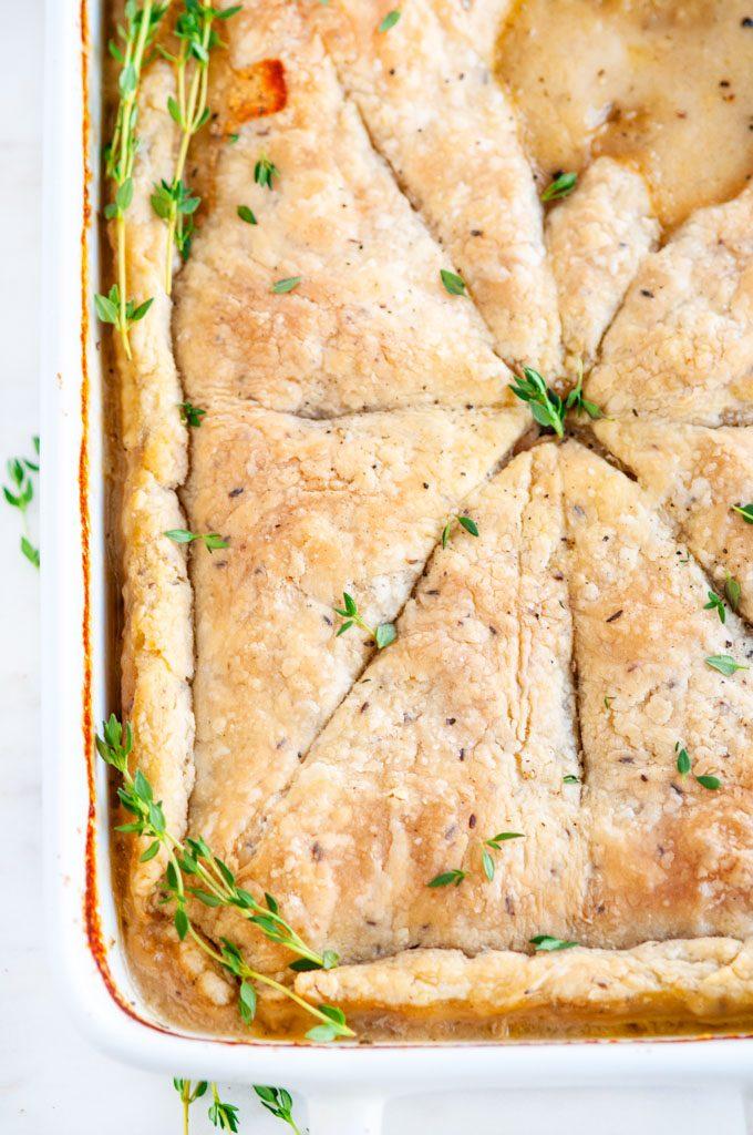 Chicken wild rice pot pie in white baking dish