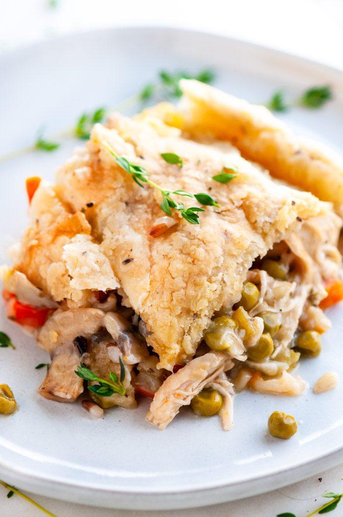 Chicken wild rice pot pie slice on white plate
