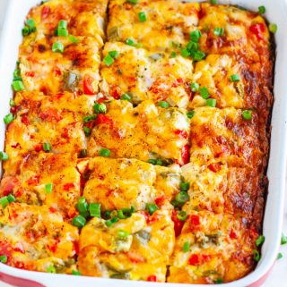 Easy Vegetarian Hash Brown Breakfast Casserole in red baking pan on white marble