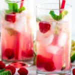 Raspberry Rhubarb Mojito with limes and tea towel on white marble