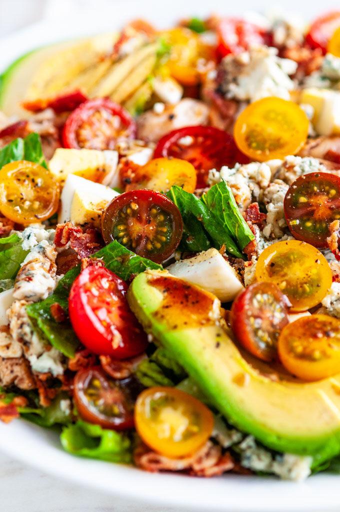 Cobb Salad with Dijon Balsamic Vinaigrette in white bowl