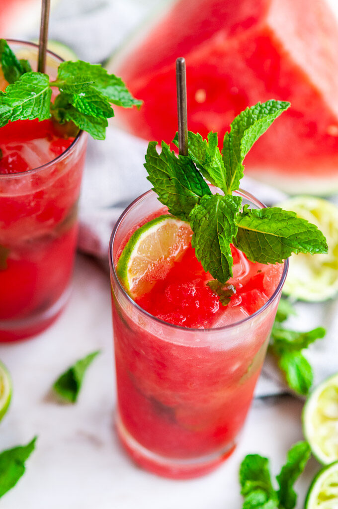 Fresh Watermelon Mojito with mint and lime on white marble