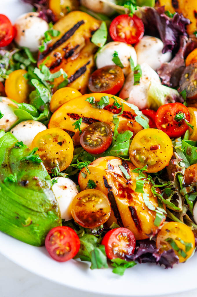 Grilled Peach Caprese Salad with avocado close up