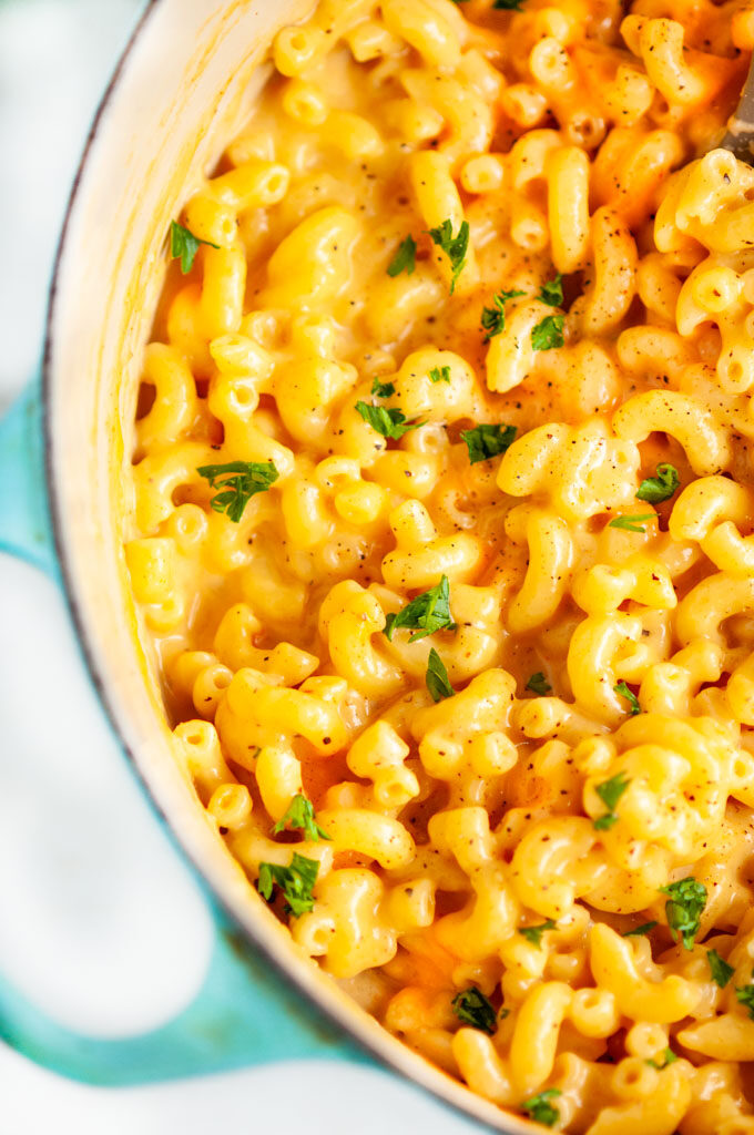 One Pot Stovetop Mac and Cheese in blue le creuset dutch oven