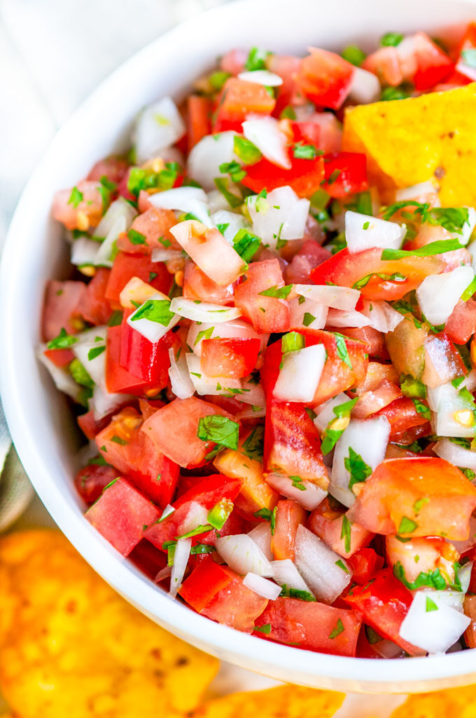 Classic Pico de Gallo salsa with chips in white bowl