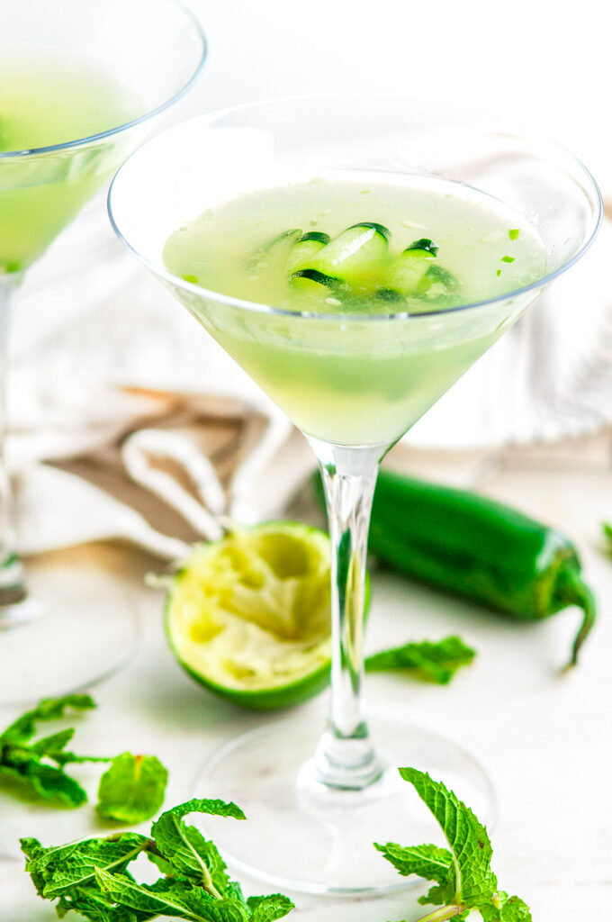 Jalapeño Cucumber Martini with tea towel on white marble