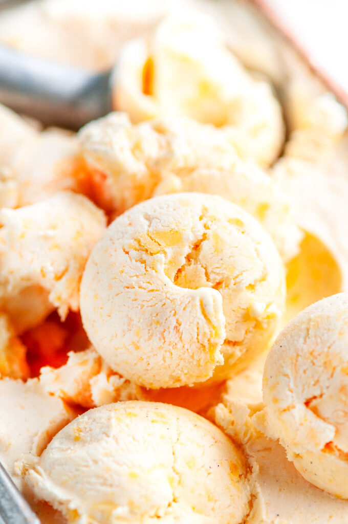 No Churn Peaches and Cream Ice Cream with gray scoop