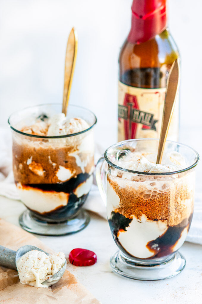 Stout Float with No-Churn Vanilla Ice Cream in glass mugs with gold spoons and bottle