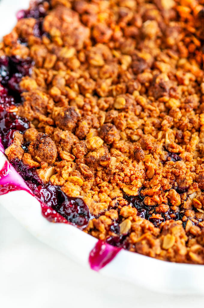 Easy Peach Blueberry Crisp in white pie pan topping close up
