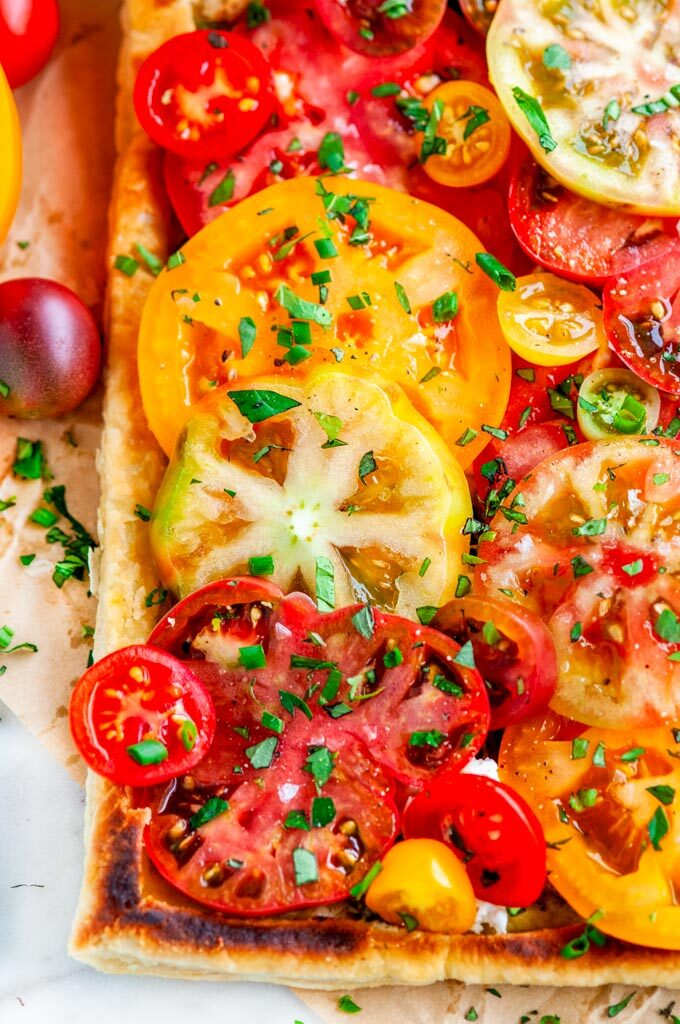 Heirloom Tomato Goat Cheese Tart on parchment paper
