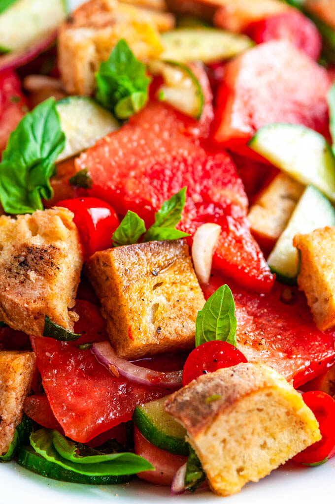 Watermelon Panzanella Salad in white bowl close up