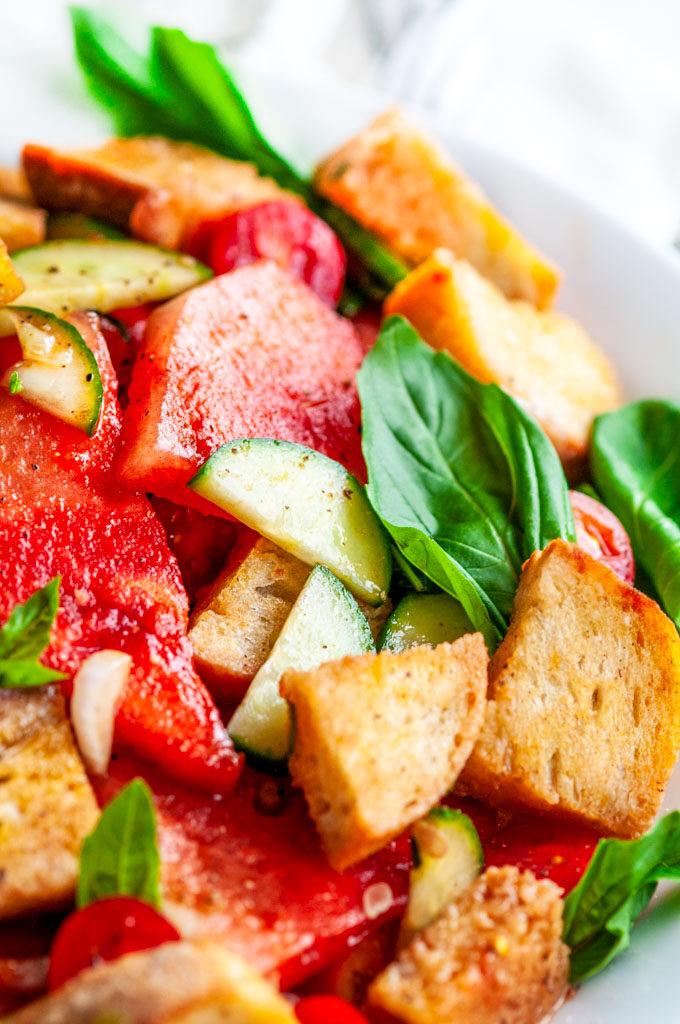 Watermelon Panzanella Salad in white bowl close up