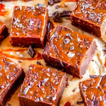 Salted Caramel Chocolate Fudge squares on brown parchment paper